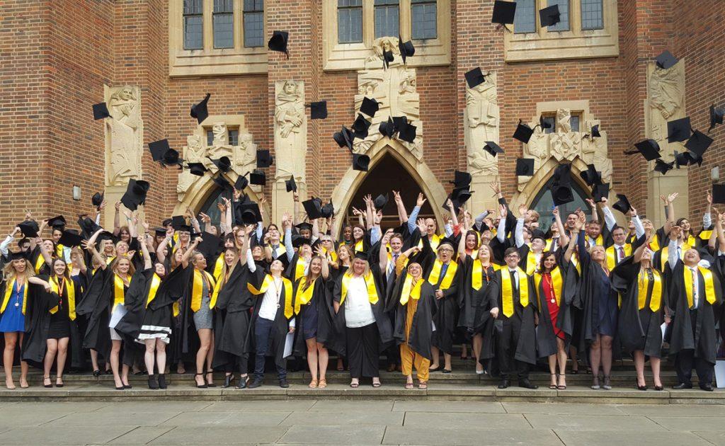 Smartphone photo of graduates throwing their caps
