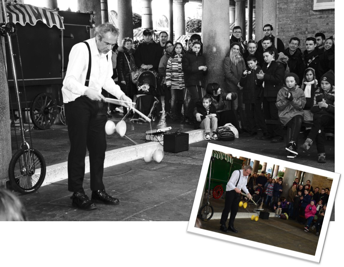 A street performer using a diablo - black and white photograph with thumbnail of the original colour shot